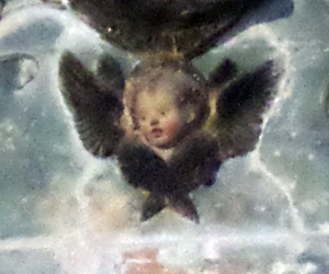 Winged baby angel head?!